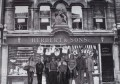 Photoshop image of the 2010 Down our Weigh team standing in front of the Herbert shop as it was in 1889